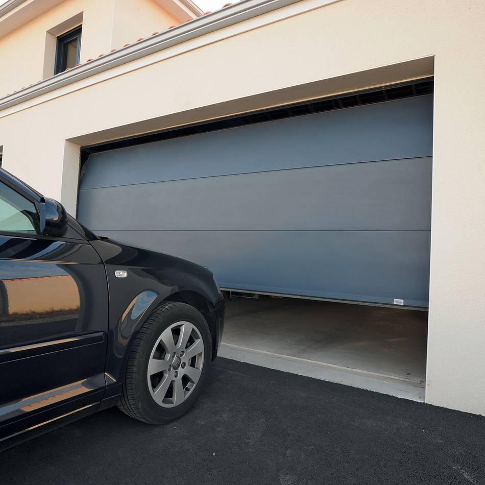 Porte de garage sectionnelle à ouverture plafond